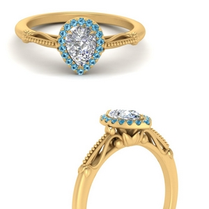 pear shaped halo floral shank blue topaz engagement ring in yellow gold FD124330PERGICBLTOANGLE3 NL YG