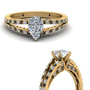delicate split shank pear engagement ring with black diamond in FDENS3131PERGBLACKANGLE3 NL YG.jpg