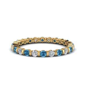 Topaz With Round Diamond Band