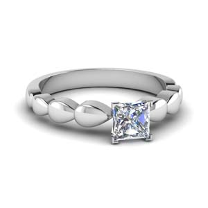 Platinum Drain Drop Solitaire Ring
