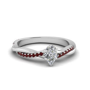 Pear Shaped Ruby Side Stone Rings