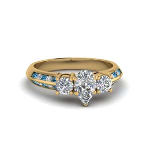 pear shaped 3 stone channel accent diamond engagement ring with blue topaz in FD8313PERGICBLTO NL YG