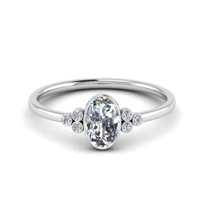 Oval Bezel Set Moissanite Ring