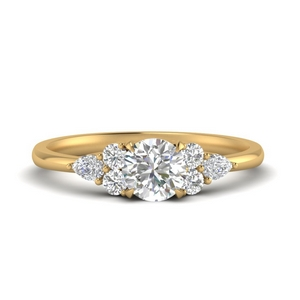 Pear Accented Round Diamond Ring