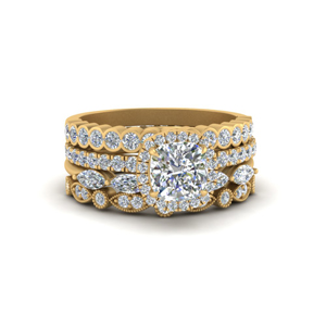 cushion halo ring with Stack wedding Bands in 18K yellow gold FD9441ANGLE2 NL YG.jpg