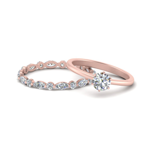 Rose Gold Solitaire Ring With Eternity Band