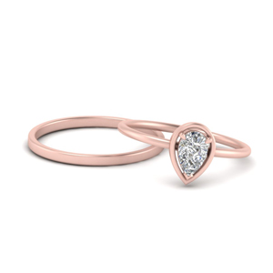 Pear Solitaire Ring With Plain Band
