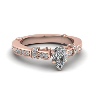Rose Gold Pear Shaped Side Stone Rings