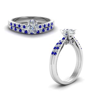 oval shaped high set milgrain diamond wedding ring set with sapphire in FDO50845OVGSABLANGLE1 NL WG